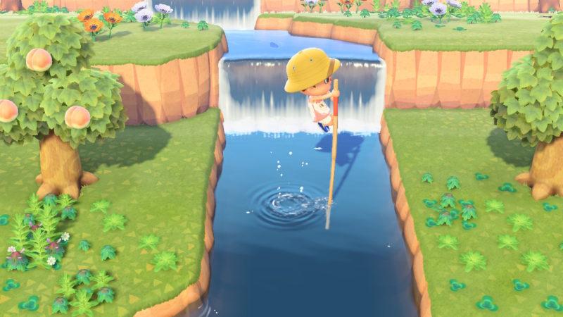 高跳び棒で川を渡る